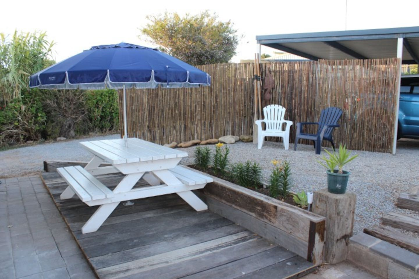 Out door area with table setting and bbq.