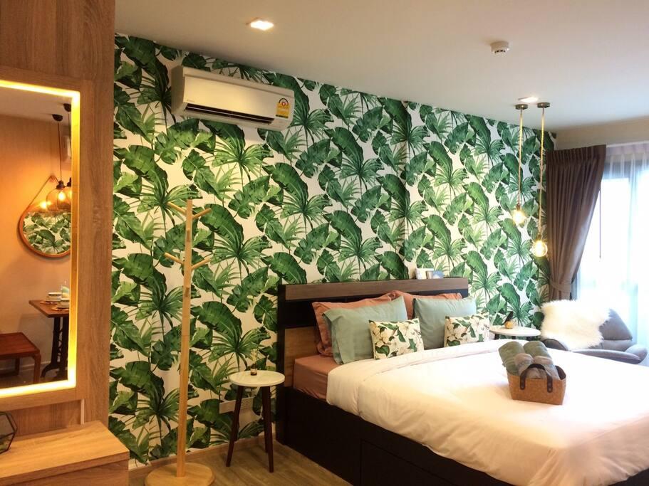 ฺBotanic-designed wallpaper with warm lights to let guest spend the best night in the most relaxing atmosphere