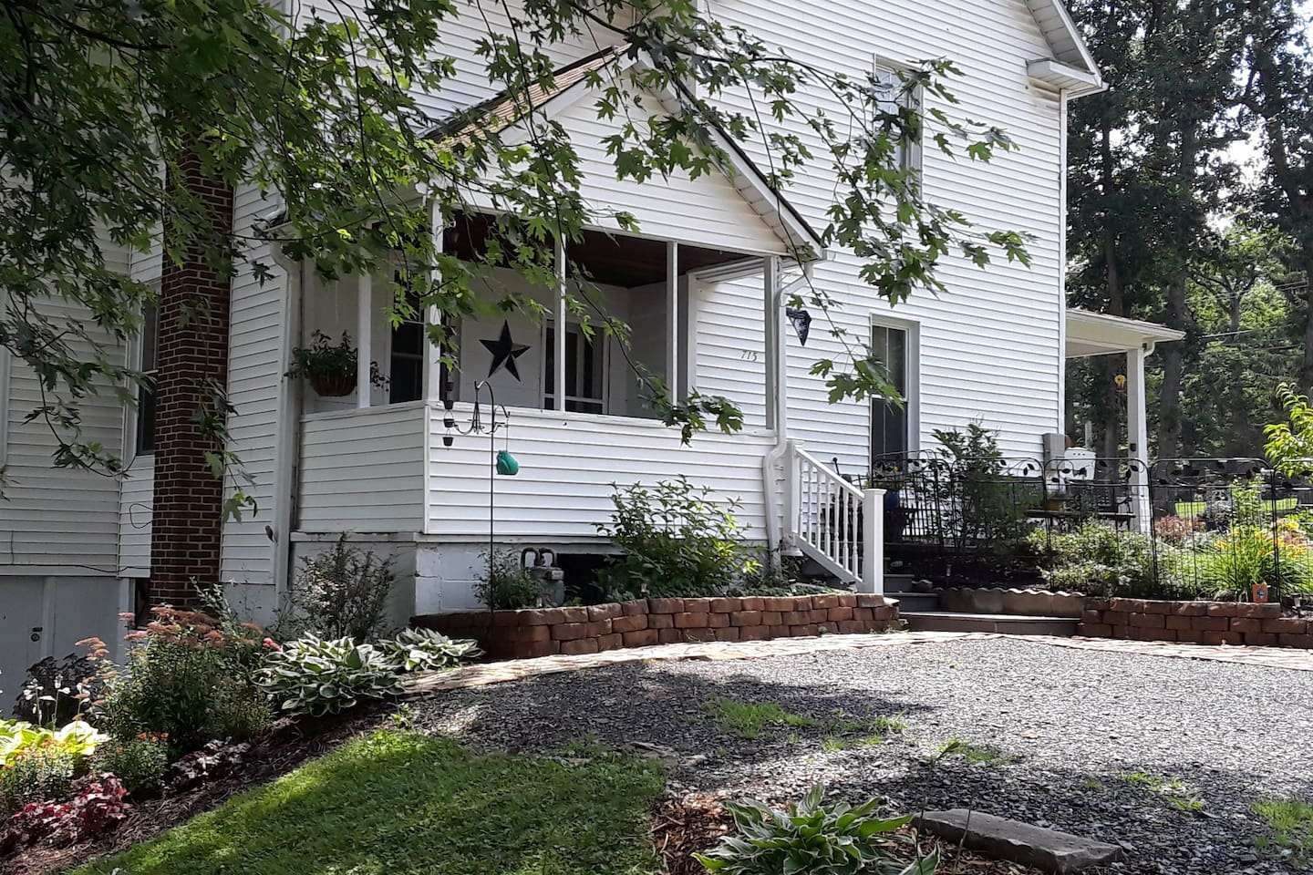 This charming attached apartment with separate entrance, porch and parking for 2 vehicles, is part of the house build in 1900. It is in a quiet residential neighborhood.