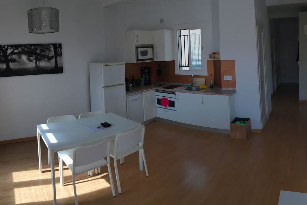 Kitchen is open plan with the living room, there is everything u need, oven, dish washer, coffe machine, fridge and electric cooker.