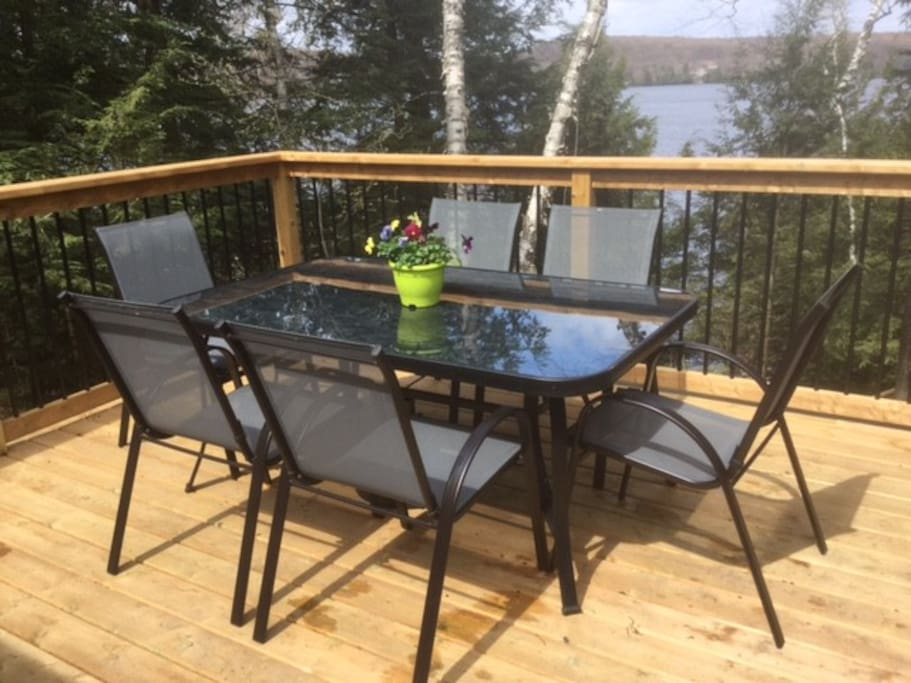 Patio furniture on deck located directly off of cottage