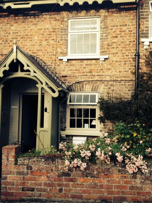 Roses almost around the door!