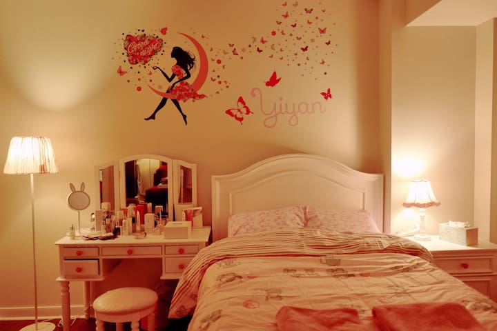 The super lovely bedroom features a pinky double bed and a dressing table.