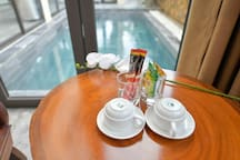 having a cup of coffee in your room with pool view