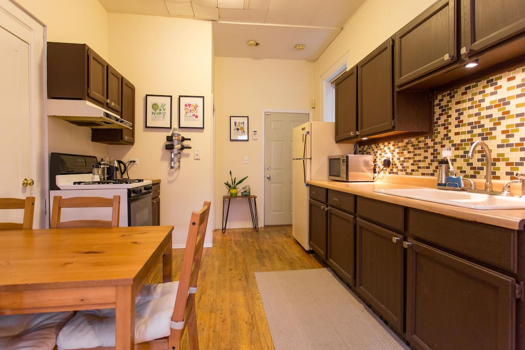 Spacious and simple kitchen with small dining room table