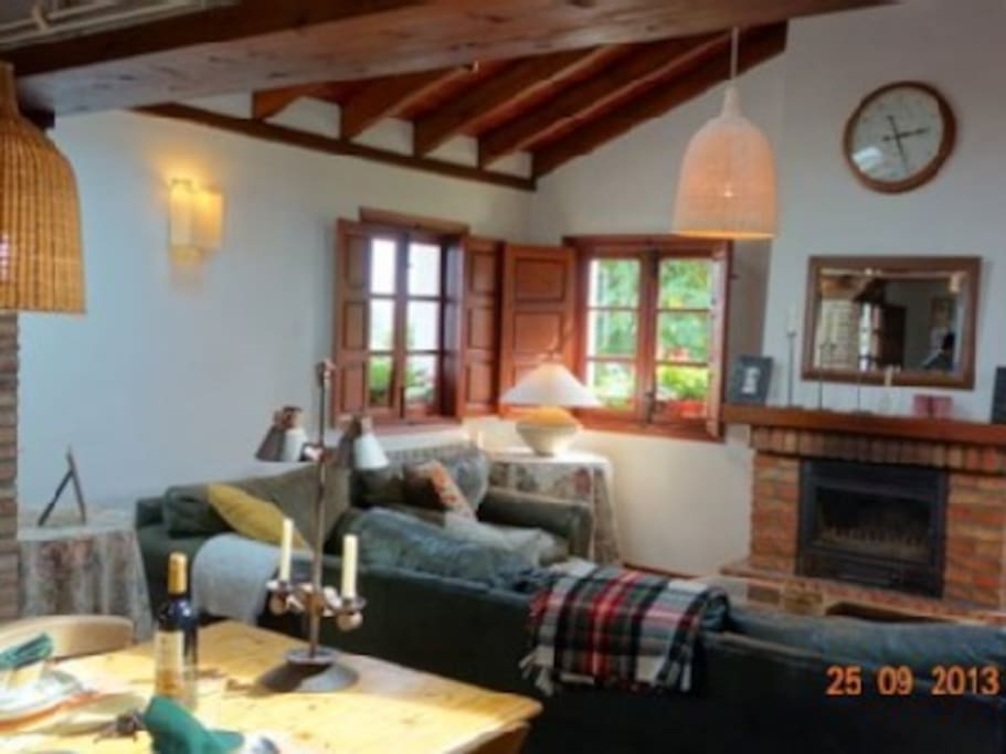 Spacious living room, complete with tv set and chimney