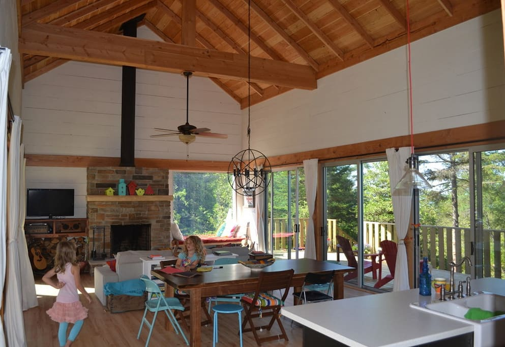 Great room with natural light on both sides and wood burning FP