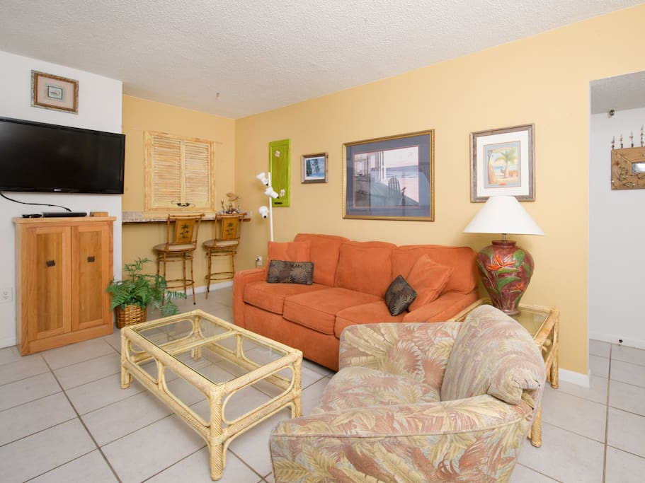 The living area has a flat screen TV. Complimentary Wi-Fi is provided.