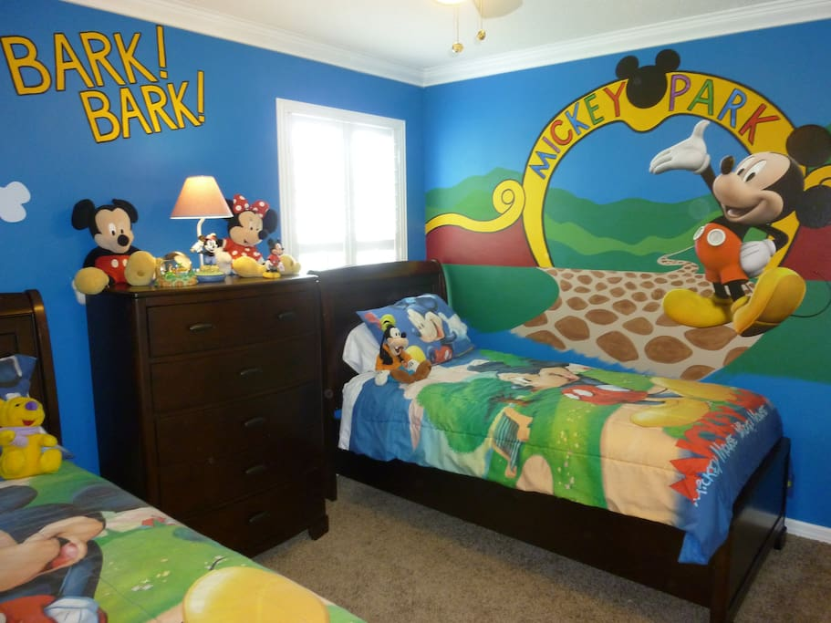 Disney room with Flatscreen TV with cable and two twin beds.