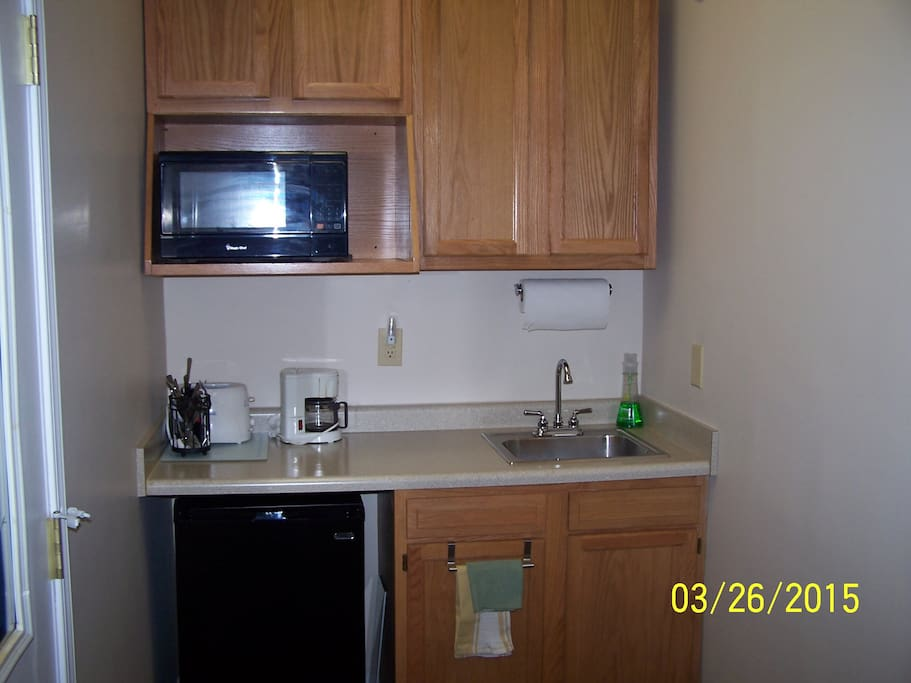 Kitchenette w/ toaster, fridge, m/wave, coffee pot & elec. skillet.