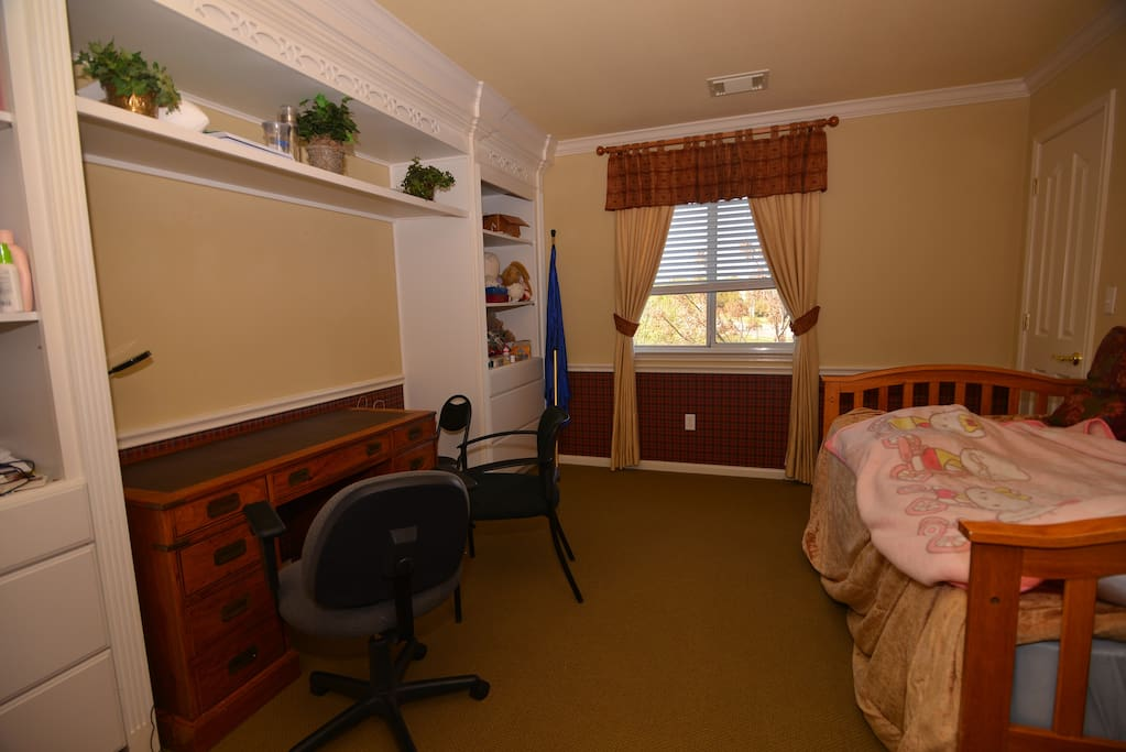room 2 with walk-in closet and view to a 10-acre park.