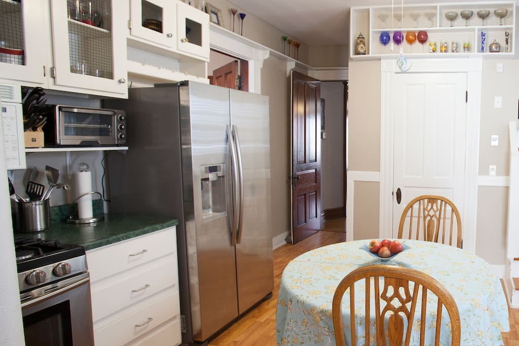 Our kitchen opens up to a small first floor full bath and a sitting area/mud room.
