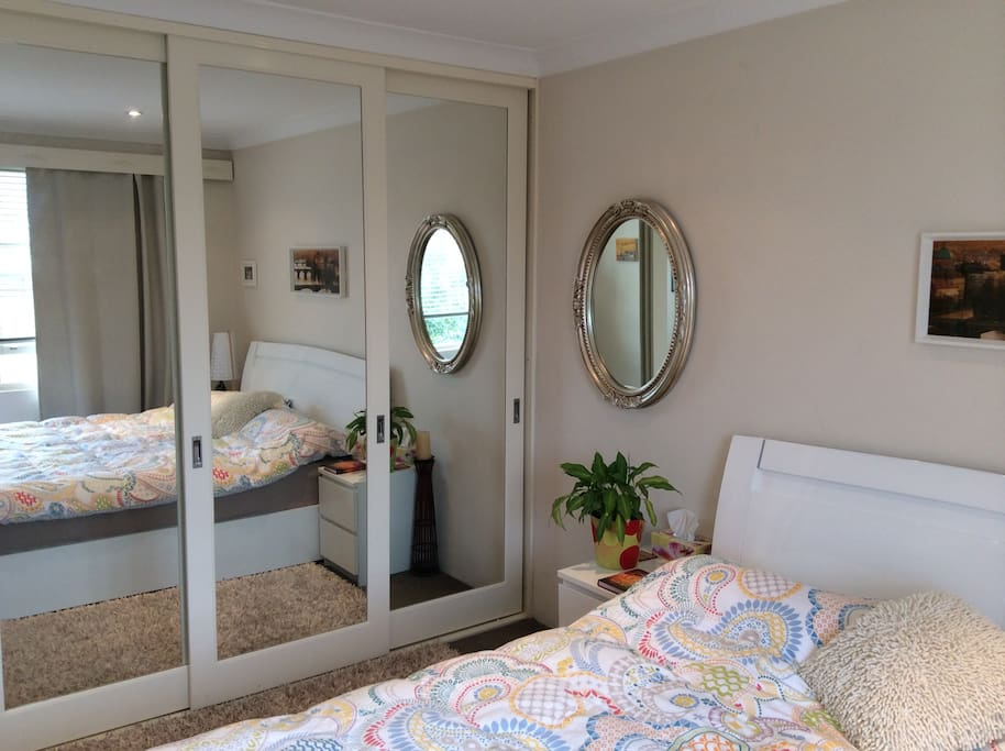 Large mirrored build in cupboard for your use.