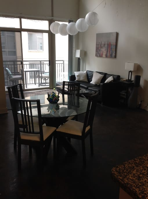 The apartment has a clean, industrial modern look and features a balcony, as well as cable TV, and chic living accommodations. This is a common space with the upstairs loft and bedroom.