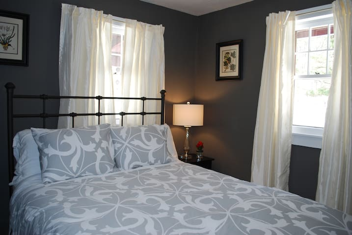 Sleep peacefully in this lovely first story queen bed.