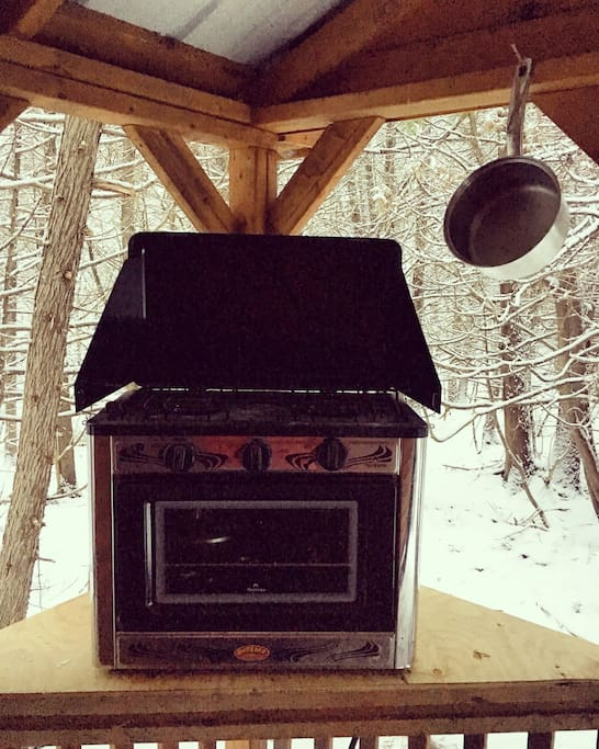 Prepare your meals on the porch with the propane stove and oven!