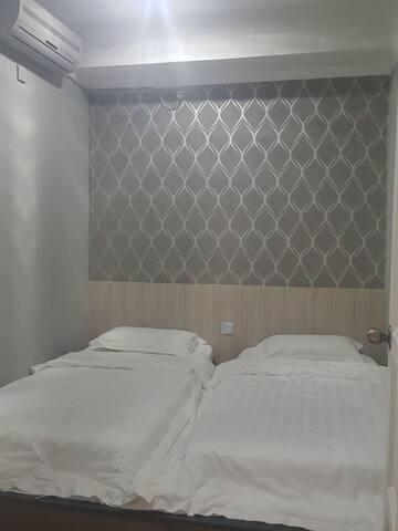 SWEETHOME温馨窝(668 二人房 单人床×2)提供免费早餐-订接机-预订跳岛游