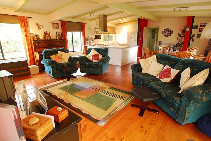 Modern kitchen in open plan living area.