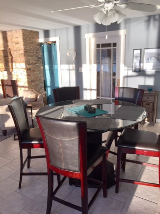 Over-sized glass dining table with seating for 6