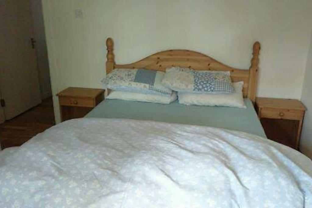 en suite bedroom with queen size bed