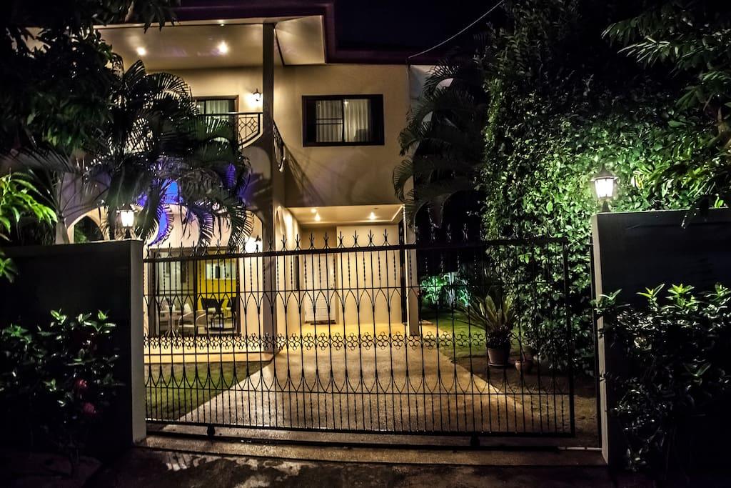 Palm Villa By Night