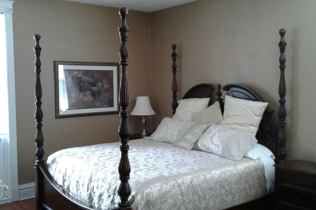 7' tall four poster king bed complimenting 10' ceilings