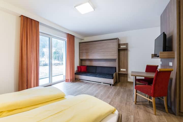 Appartement séduisant avec local à ski, parking et jardin