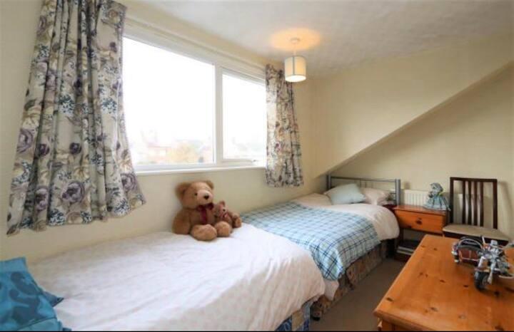 A cosy bedroom in a quiet house / neighbourhood.