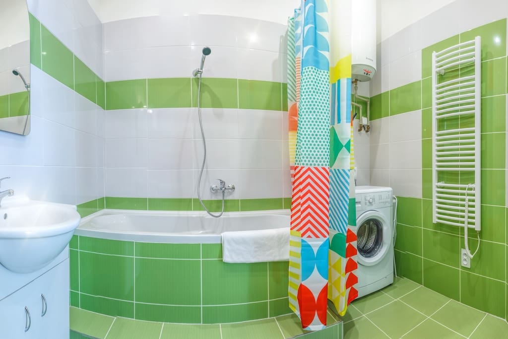 Bright bathroom with washing machine.