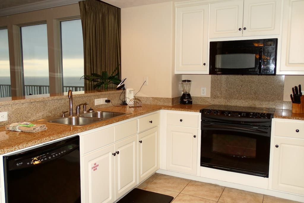 Treasure Island 812, fully stocked kitchen with gulf front view