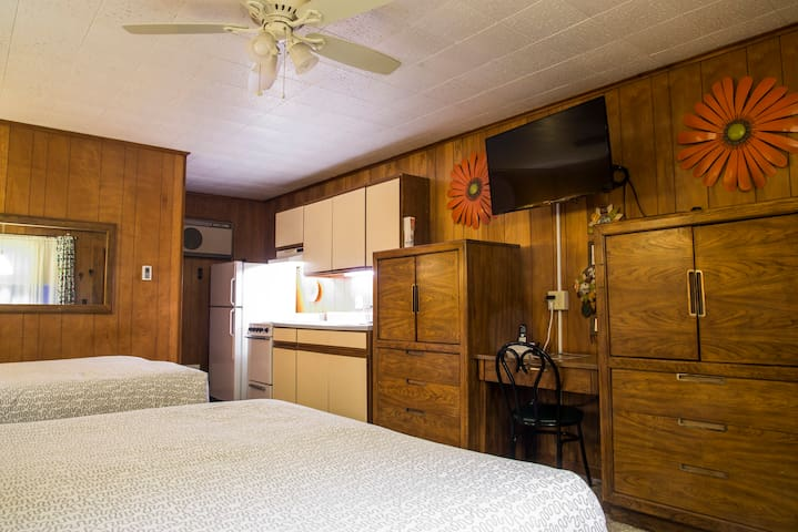 Plenty of storage and notice the ceiling fan in addition to AC.