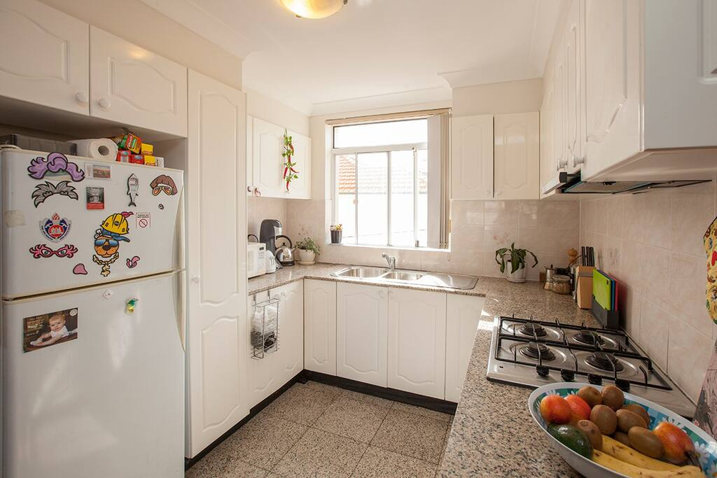 Modern kitchen with microwave and gas stove.