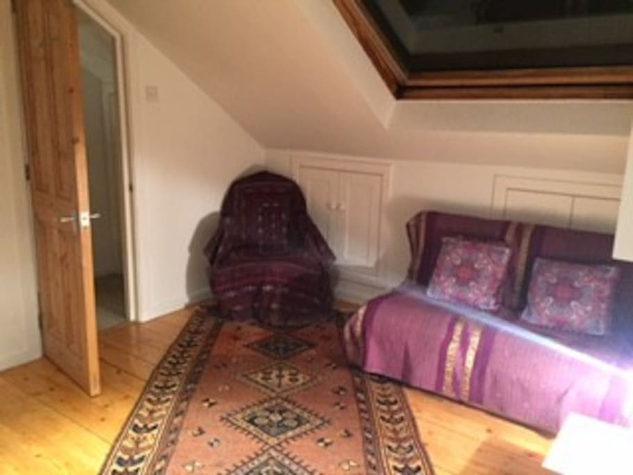 Double room upstairs bedroom with seating area - cosy at night- now with sofa