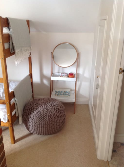 There is a small built in wardrobe, hangers provided. and a vanity unit, with a hairdryer.