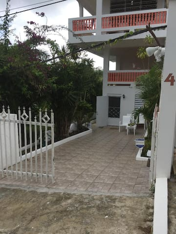 Your private entry way.  You can park your car right in front of your garden Villa.  There is a beautiful BBQ/sitting area just to the left of the entryway, behind your Villa, overlooking the lush jungle of El Yunque.