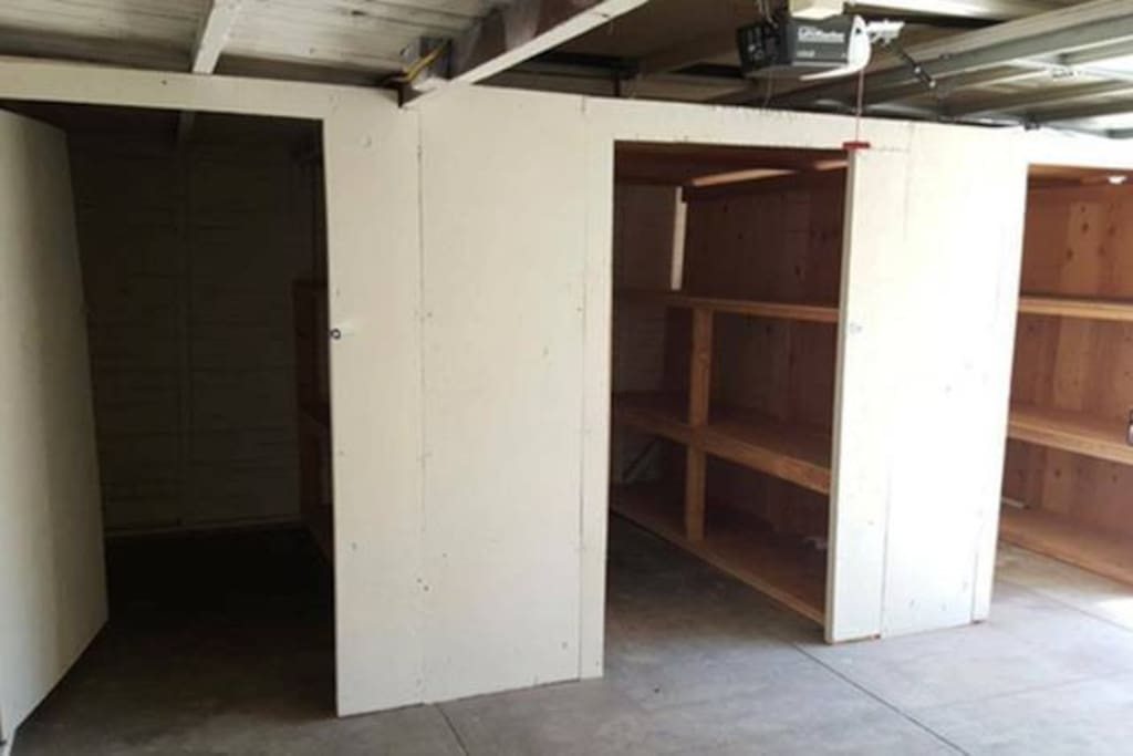 The shared space. Right side of the garage: Space can hold a queen mattress + storage shelves. Outlets and lighting are available