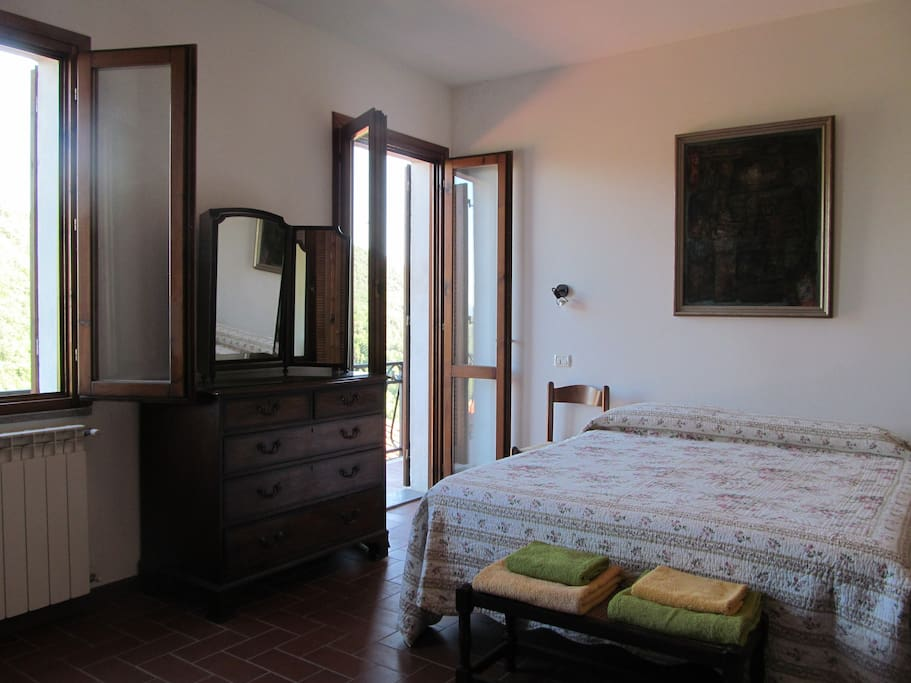 double bedroom with balcony, with different view.