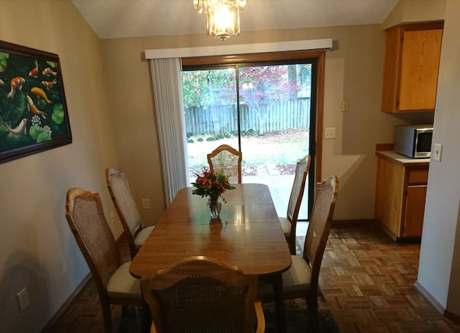 Centrally located dining area next to the kitchen and has with access to the backyard.