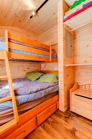 The bedroom has ample storage for your stay.
