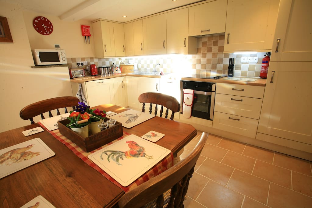 Fully equipped kitchen with electric cooker & hob, dishwasher, fridge freezer, washing machine & microwave oven.