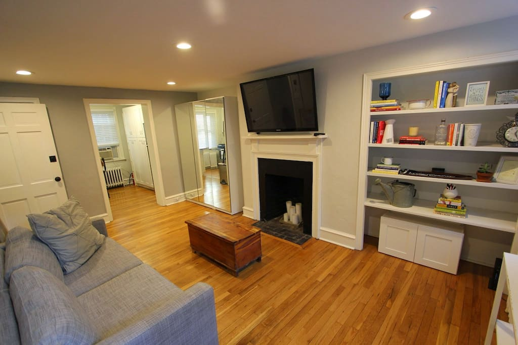 Hardwood floors, flat screen TV, and couch make for a comfortable living room