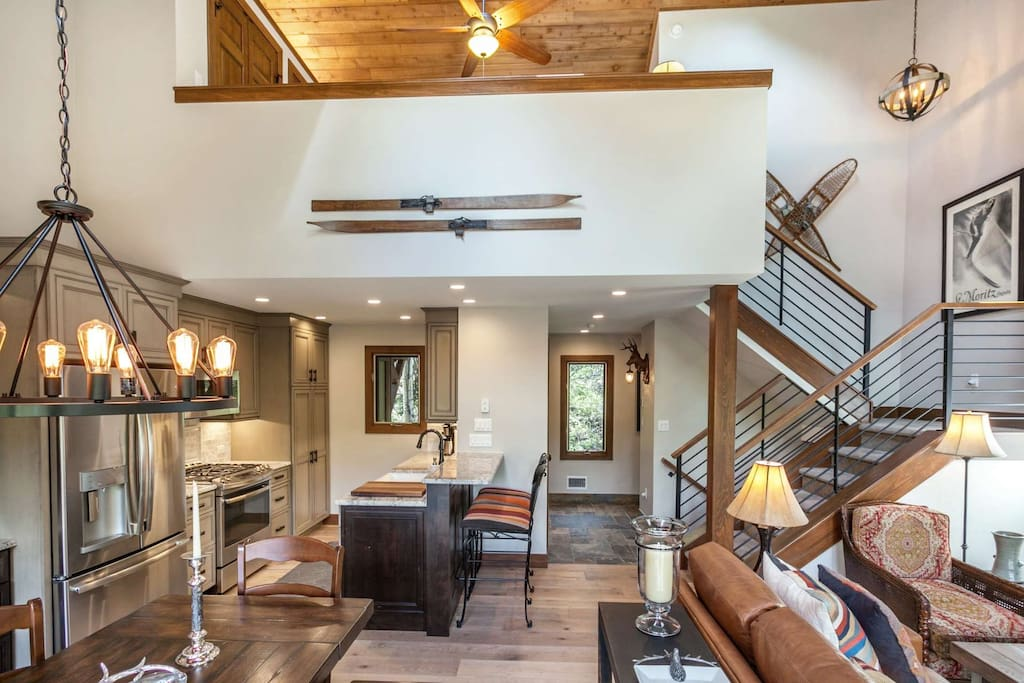 Open floor plan combines kitchen, dining and living room with views to the upstairs master loft.