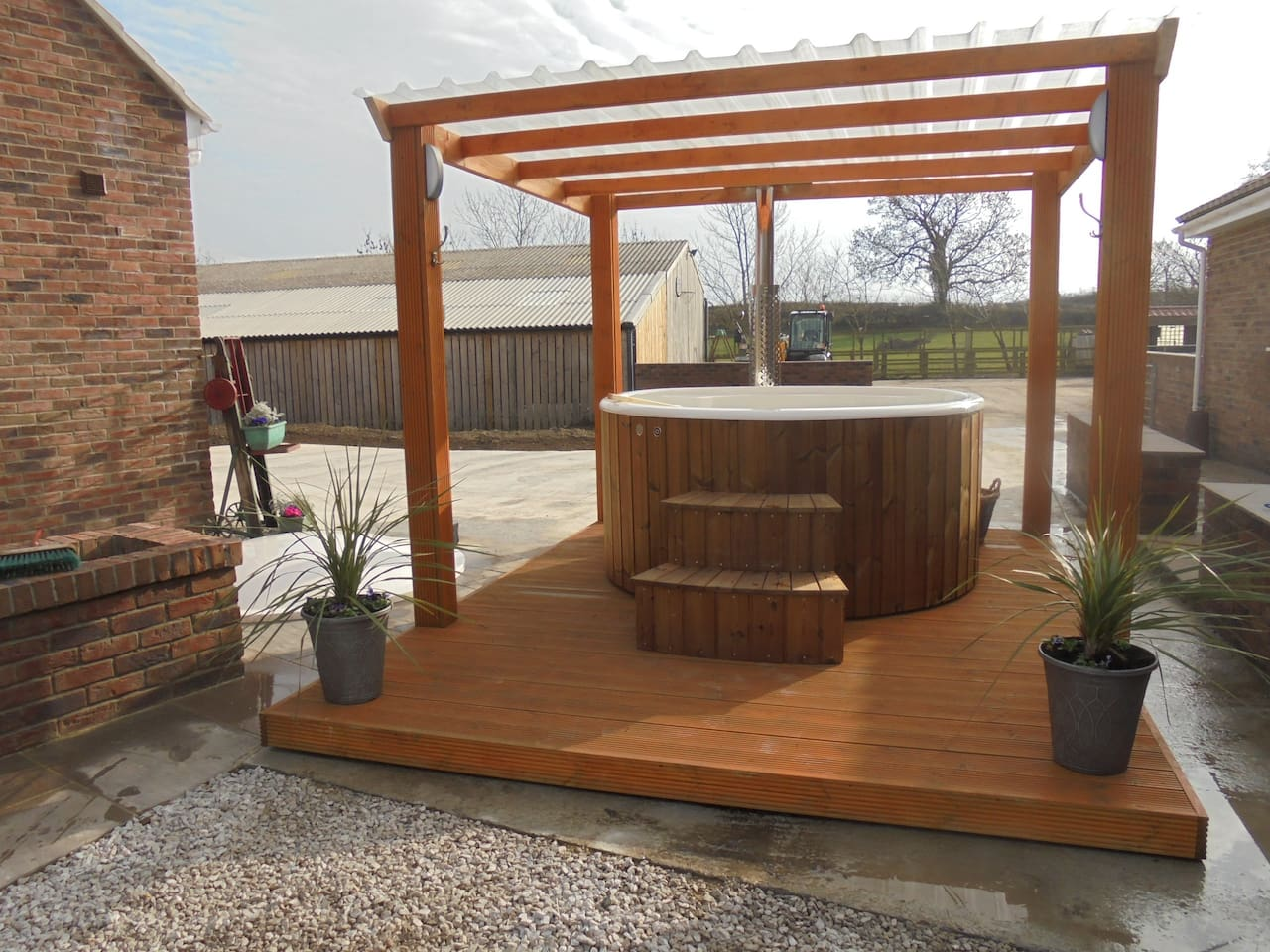 our new 6 person wood fired hot tub for hire, towels and robes included and covered pool in garden available, when you book our new cottage which sleeps 6 near knaresborough north yorkshire