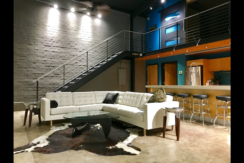 Living Room w/ Leather Sofa & Nogucci Coffee Table