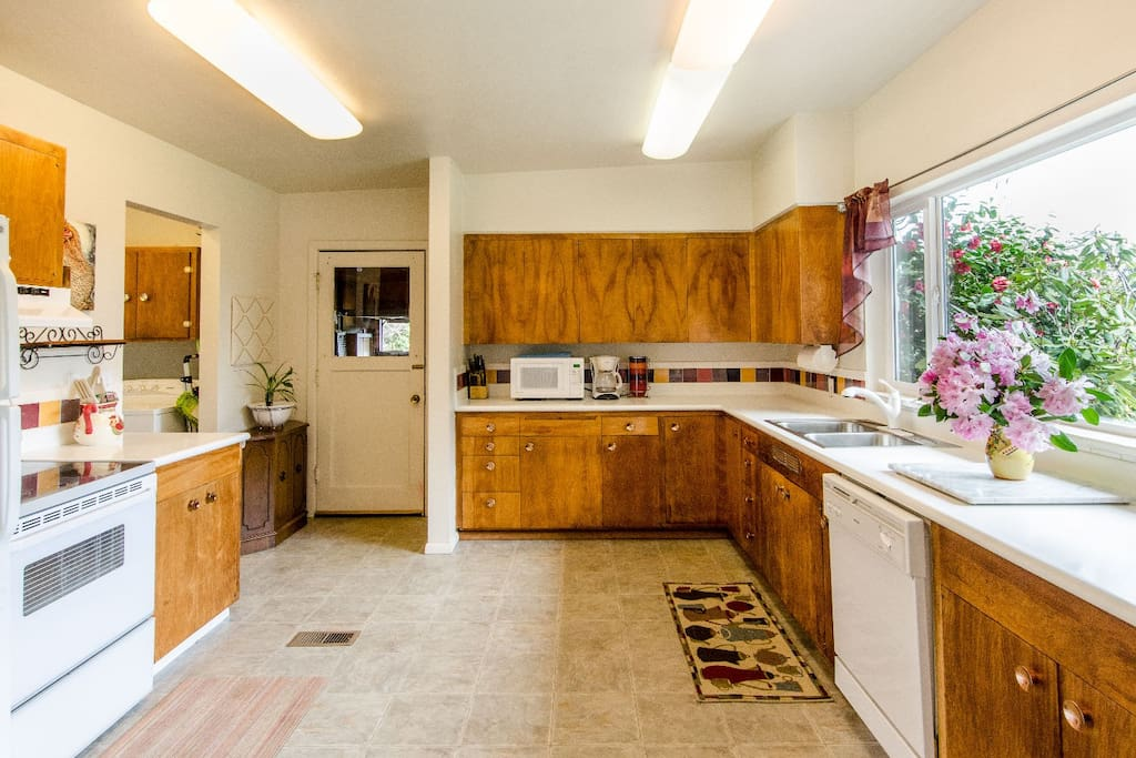 Kitchen that leads into the laundry room and another bathroom with a shower.