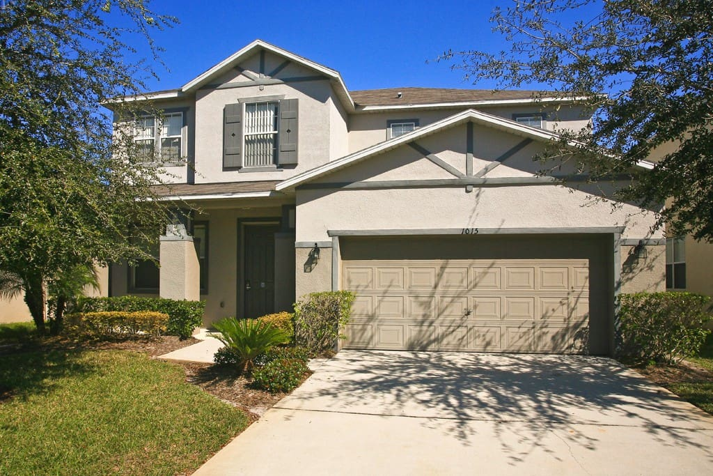 Mature gardens surround this large vacation home on the Somerset community in Kissimmee.