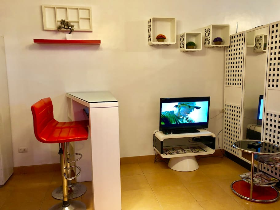 High top table and living room with tv