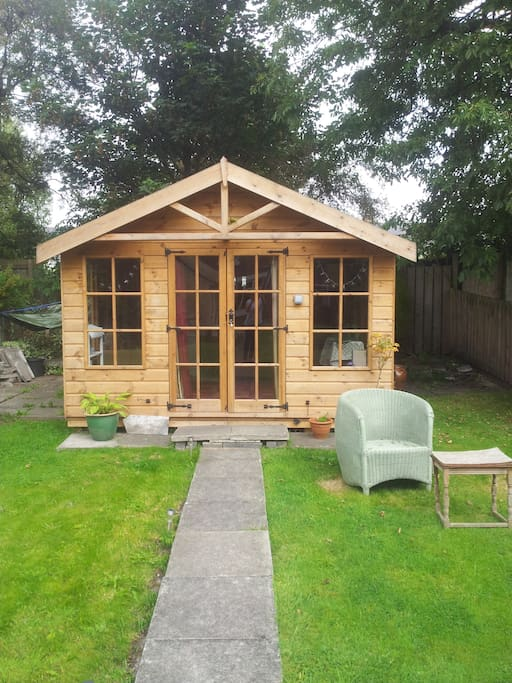 Large rear garden, with summer house for sunny days