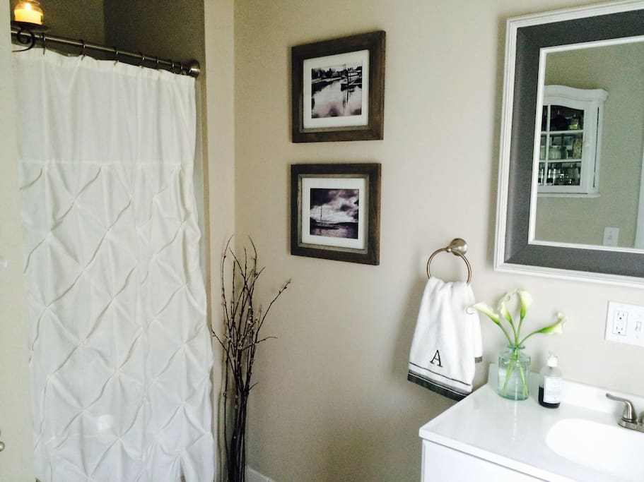 The Bathroom is located right off of the kitchen. We have towels, facecloths, shampoo & conditioner here for you.
