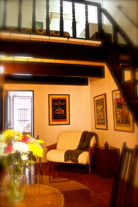A seating area with stairs to the loft.